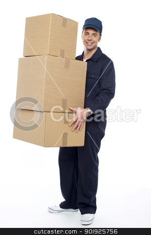 Here are your cartons ma'am stock photo, Smiling delivery guy carrying cardboard boxes, full length portrait by Ishay Botbol