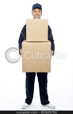 Young relocation staff member holding cardboard boxes stock photo, Young relocation staff member holding cardboard boxes. Isolated on white by Ishay Botbol