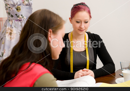 Shopping time stock photo, Customer with sales woman in clothing shop by Picturehunter