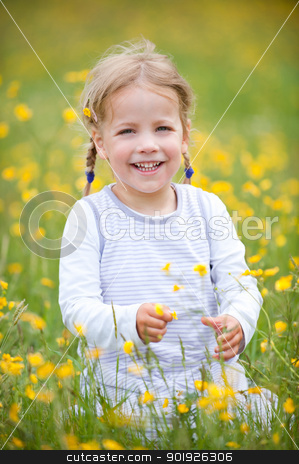 Smiling young girl stock photo, Smiling young girl sitting in the green by Picturehunter