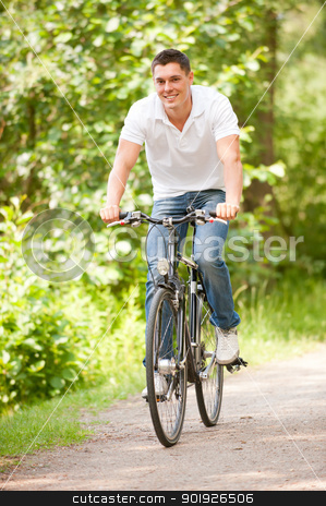 Biker in the park stock photo, Young and smiling biker in the park by Picturehunter
