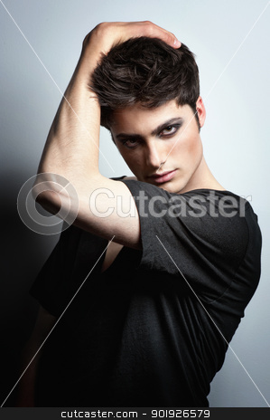 Fashion shoot with male model stock photo, Young mal model posing in the studio by Picturehunter