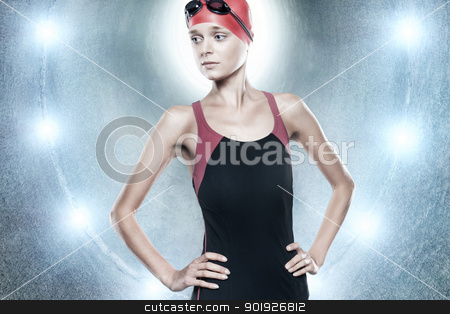 Water girl stock photo, Young swimmer girl standing in blue tunnel in front of lights by Picturehunter