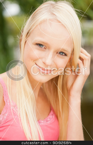 Young and smiling woman stock photo, Portrait from a young and beautiful woman by Picturehunter