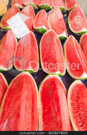 Watermelon stock photo, Freshly sliced watermelon on stand at market by Paul Prescott