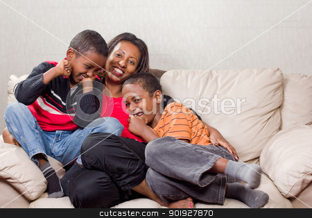 Loving mother with her sons stock photo, A loving mother sharing happy moments with her two sons by derejeb