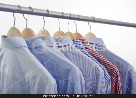 shirts hanger stock photo, clothes hanger with shirts isolated on white background by tommaso79
