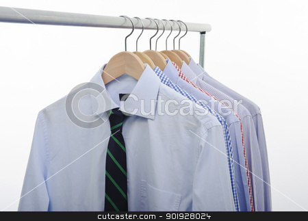 tie shirts hanger stock photo, hanger with shirts and necktie isolated on white backgrund by tommaso79