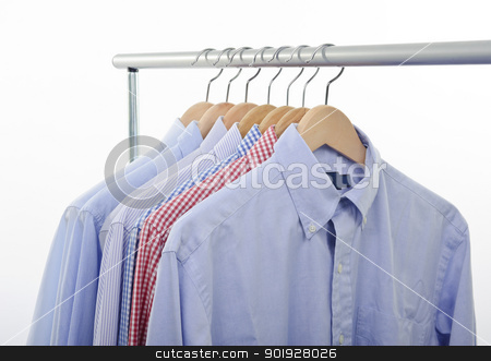 hanger and shirts stock photo, view of shirts and hanger isolated on white background by tommaso79