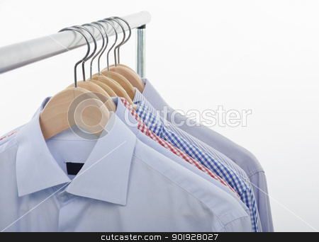 front shirts stock photo, front view of shirts and hanger isolated on white background by tommaso79