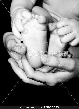 Baby Feet stock photo, An infants feet being held in the loving hands of mother. by Cora Reed