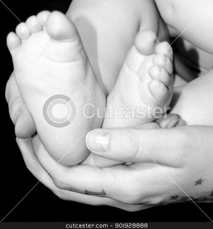 Baby stock photo, A very cute little infant feet in a mother's hands by Cora Reed