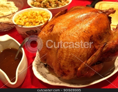 feast stock photo, Feast for the holidays with a perfect turkey by Cora Reed