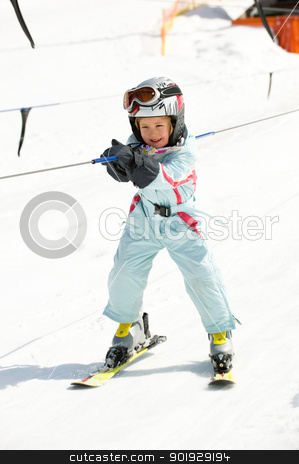 Girl in ski lift stock photo, Little girl with ski suit in the ski lift  by Picturehunter