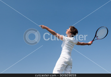 Senior tennis player stock photo, Active senior woman is playing tennis in front of blue sky by Picturehunter