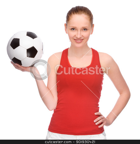 Girl with ball stock photo, Full isolated studio picture from a young and beautiful woman with football by Picturehunter