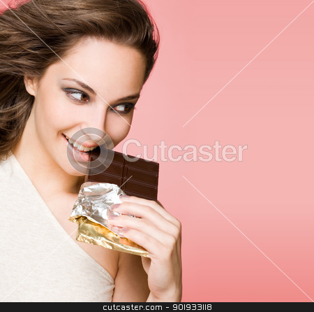 Chocolate loving beauty. stock photo, Portrait of a chocolate loving brunette beauty on pink background. by exvivo