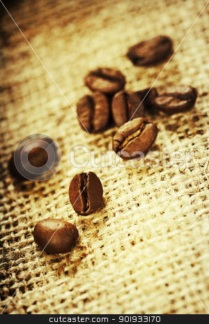 coffee beans stock photo, Close up of coffee beans on cloth sack  by klenova