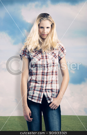 Beautiful girl stock photo, Beautiful young woman over a wall painted with a beautiful green meadow by ikostudio