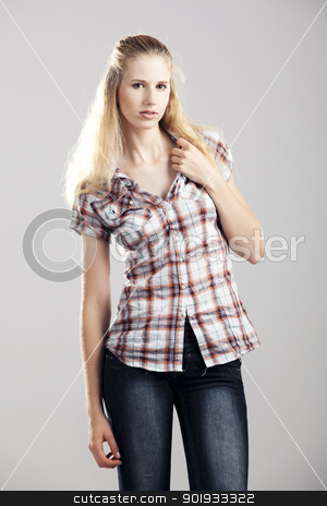 Beautiful young woman stock photo, Beautiful young woman over a gray background by ikostudio