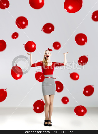 Woman with red ballons stock photo, Beautiful fashion woman in red posing with red ballons by ikostudio