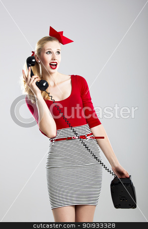 Fashion woman with a phone stock photo, Beautiful fashion woman with a astonished expresion and holding a  vintage phone by ikostudio