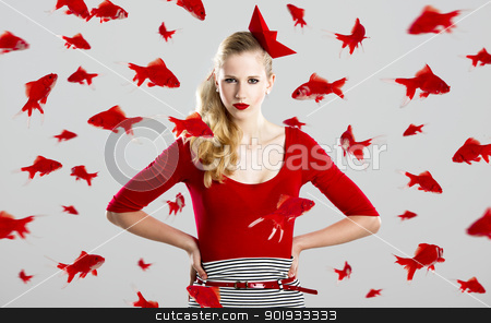Fashion woman with red fishes stock photo, Beautiful fashion woman with red fishes around her by ikostudio