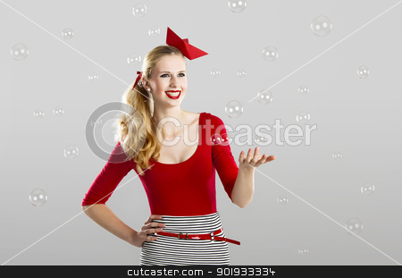 Fashion woman with water bubbles stock photo, Beautiful fashion woman in red posing with water bubbles around her by ikostudio