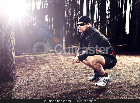 Runner stock photo, Athletic man resting after running in the forest by ikostudio