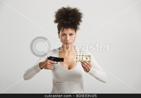 Shooting money stock photo, African woman shooting a US-Dollar banknote, great concept for the global crises by ikostudio