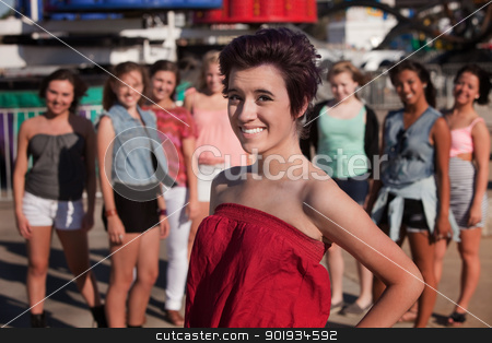 Smiling Teenage Girl In Front of Friends stock photo, Pretty Hispanic teenage girl in front of group friends by Scott Griessel