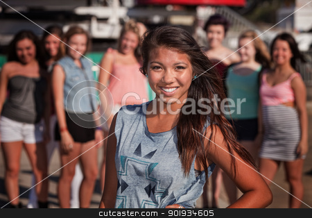 Cheerful Teenager with Smile stock photo, Cheerful Asian teenage girl smiling with friends nearby by Scott Griessel