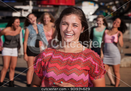 Giggling Teen AGirls stock photo, Giggling teenage girl with group of friends by Scott Griessel