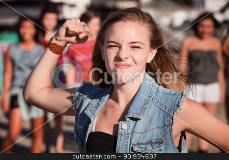 Angry Teenage Girl stock photo, Angry young girl in denim jacket shakes her fist by Scott Griessel