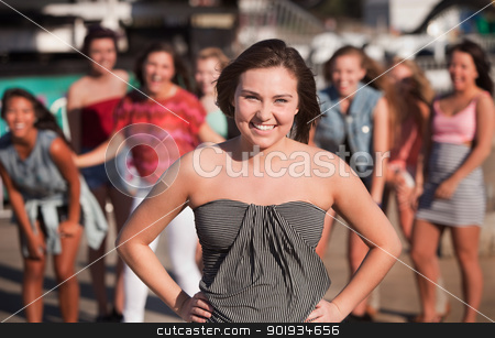 Smiling Young Woman with Friends Outside stock photo, Happy teenage girl at carnival with friends by Scott Griessel