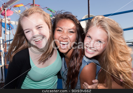 Three Friends Laughing Together stock photo, Three Asian and white teenage friends laughing together by Scott Griessel