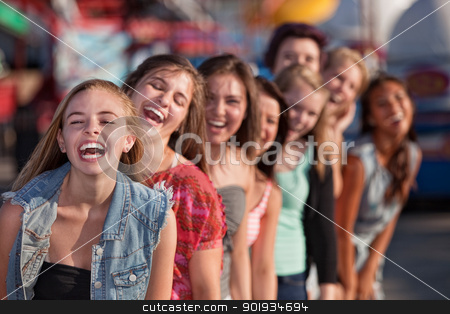 Group of Girls Laughing stock photo, Group of eight girls in a row laughing by Scott Griessel