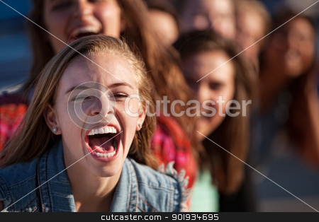 Shouting Girl Outside stock photo, Young happy white teenage girl shouting with friends by Scott Griessel