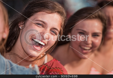 Young Woman Laughing stock photo, Close up of laughing European teenage girls outdoors by Scott Griessel