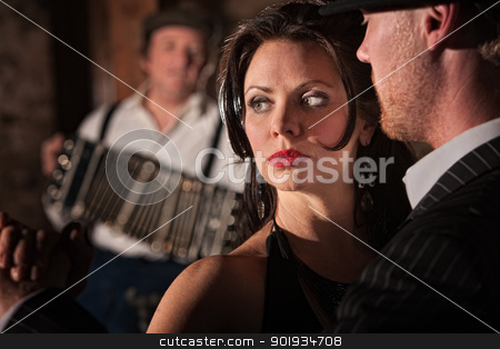 Tango Dancers Performing stock photo, Handsome European couple dancing tango in rustic urban setting by Scott Griessel