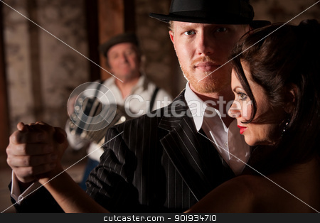 Handsome Tango Dancer with Partner stock photo, Attractive tango dancer in hat with beautiful partner by Scott Griessel