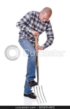 Gardener with a hayfork stock photo, Full isolated studio picture from a young gardener with a hayfork by Picturehunter