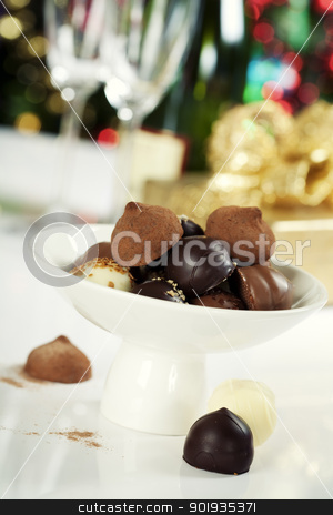 chocolate pralines and truffles stock photo, Delicious chocolate pralines and truffles on Christmass tree background by klenova