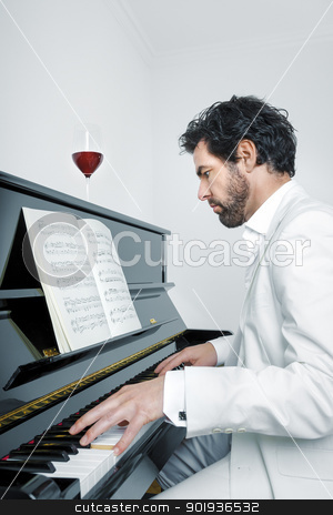 man with piano stock photo, An image of a handsome man playing the piano by Markus Gann
