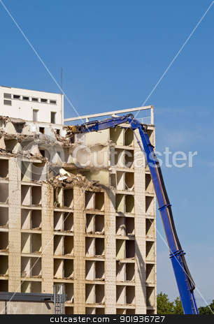 Building demolition stock photo, Machine taking down a large residential building by Harry Huber