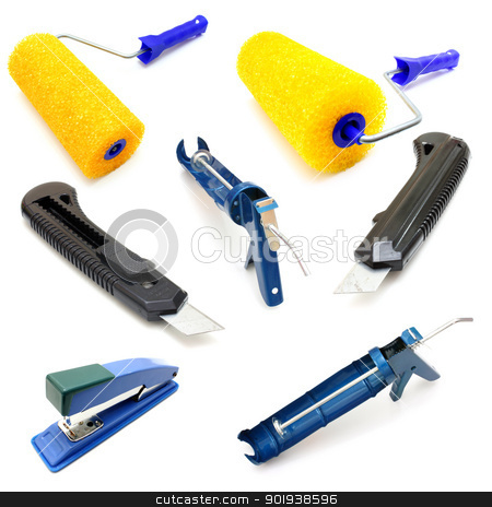 Set the roller for painting stock photo, Set the roller for painting, knife, stapler and glue gun. by aarrows