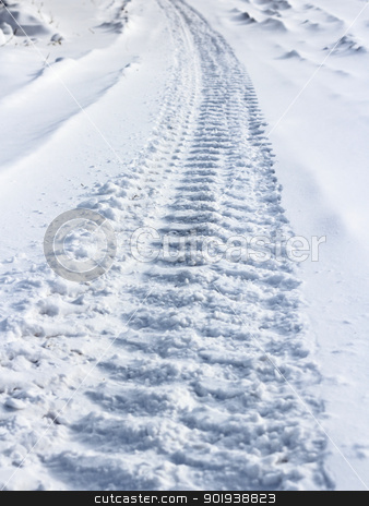 Traces from wheels of the  car on snow stock photo, Traces from wheels of the  car on snow by aarrows