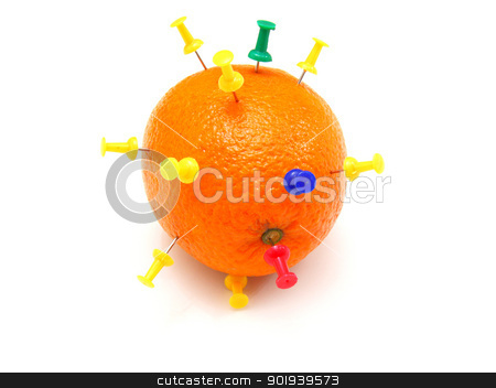 Isolated colourful office pins thrust in an orange stock photo, Isolated colourful office pins thrust in an orange by aarrows