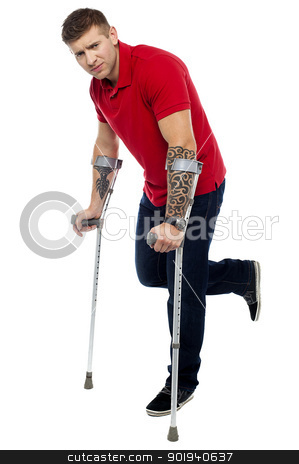 Painful expression of young guy walking with help of crutches stock photo, Painful expression of young guy walking with help of crutches. Looking at camera by Ishay Botbol
