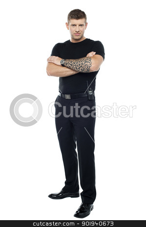 Bodyguard with tattoo. Posing with folded arms stock photo, Bodyguard with tattoo. Posing with folded arms, looking at you by Ishay Botbol